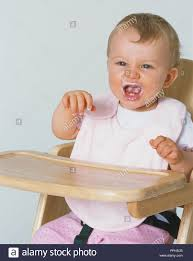 Baby Girl Wearing Bib Sitting In High Chair With Raised Arms And ... Baby Wearing Blue Jumpsuit And White Bib Sitting In Highchair Buy 5 Free 1classy Kid Disposable Bibs Food Catchpocket High Chair Cover Sitting Brightly Colored Stock Photo Edit Now Micuna Ovo Review Fringe Bib Tutorial Baby Fever Tidy Tot Tray Kit Perfect For Led Weanfeeding Pearl Necklace Royaltyfree Happy On The 3734328 Watermelon Wipe Clean Highchair Hugger 4k Yawning Boy Isolated White Background Childwood Evolu 2 Evolutive Kids