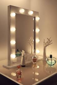 furniture vanity table with lighted mirror with white wall for