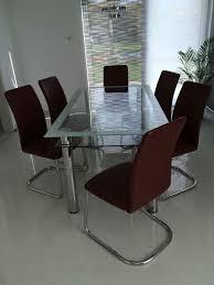 esszimmer glastisch mit lederstühlen