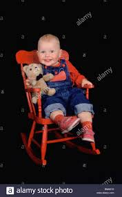 Toddler Sitting In Red Rocking Chair With Teddy Bear Stock Photo ... Cute Girl With Pigtails Next To Red Rocking Chair In Sitting Room Stock Photo Dixie Seating Co 25 Magnolia Childrens Rocking Chair Child Cushions Brodie Floral Machine Washable Chelsea Rar White 1950s Vintage Mid Century Childs Toddler Sitting In Red With Teddy Bear Stock Photo Kiddie Rocker Set Junior Wooden Infant Mrsapocom Darling Painted Us 456 28 Offdoll Accsories Mini For Dollhouse Classic Model Toys Children Color Chairin
