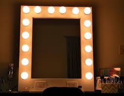 large wall mirror with light bulbs decofurnish