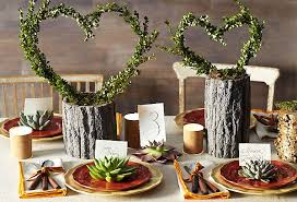 And Flexible Boxwood Branches Are Easily Formed Into Heart Shape Centerpieces Anchored In Faux Bois Fake Wood Planters