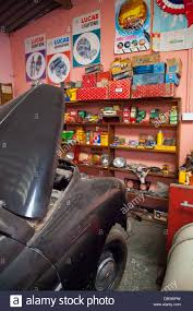 Interior Of A Vintage Garage With Car Spares In Original Packaging And Signs Posters Cae Dai 1950 Museum Denbigh