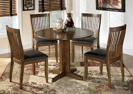 Stuman Round Drop Leaf Table W 4 Side ChairsSignature Design By Ashley