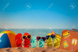 Flip Flops Beach Ball And Suitcase On The Sand Summer Vacation Concept Stock