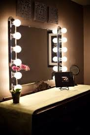 vanity mirror with light bulbs around it also bedroom vanity with