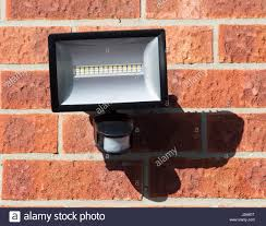 led floodlight with pir motion sensor wall mounted stock photo