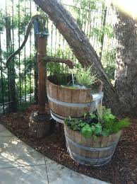 We Took An Old Water Pump And 2 Half Wine Barrels To Create This ... Outdoor Fountains At Lowes Pictures With Charming Backyard Expert Water Gardening Pond Pump Filter Solutions For Clear Backyards Mesmerizing For Water Fountain Garden Pumps Total Pond 70 Gph Pumpmd11060 The Home Depot Large Yard Outside Fountain Have Also Turned An Antique Into A Diy Bubble Feature Ceramic Sphere Pot Sunnydaze Solar Pump And Panel Kit 80 Head Medium Oput 1224v 360 Myers Well Youtube