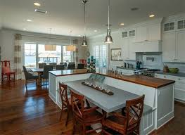 Traditional Kitchen With L Shaped Island Wood Counter Attached Bench And Dining Table