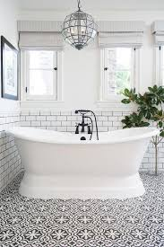 white and black bathroom with bordeaux cement tiles transitional