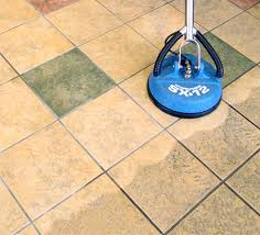 cleaning floor tiles and grout on floor and cleaning