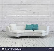 eleganten weißen sofa mit weißen und grünen kissen auf einer