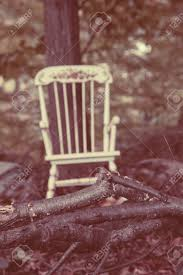 A Vintage Child's Rocking Chair Sits In The Middle Of The Woods. Style Selections Wood Rocking Chairs With Slat Seat At Lowescom Jack Post Oak Childrens Patio Rocker Norwegian Chair Chesspatterns 194050s By Per Aaslid Norway For Nursery Parc Rocking Chair 11468 S001 Rocking Chair Black S Bent Bros Antiques Board Outdoor Interiors Resin Wicker And Eucalyptus Brown Grey Seattle Mandaue Foam Song
