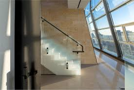 100 Greenwich Street Project Brick Wall With Rough Brick Wall White Staircase With Glass Railing