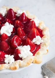 This homemade strawberry pie is made with a flaky crust cheesecake filling and bursting with
