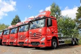 LIETO, FINLAND - AUGUST 3 Row Of Red Mercedes Benz Actros Trucks ...