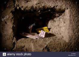 slips of paper containing prayers wedged into the cracks of the