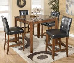 Theo 5-Piece Square Counter Height Table Set With Bar Stools By Signature  Design By Ashley At Furniture And ApplianceMart