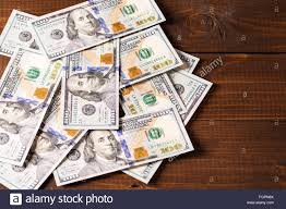 new 100 US dollars bills on wooden background Stock Royalty