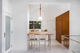 Breakfast Nook Ideas For Small Kitchen by Small Contemporary Kitchen Makes Room For Home Office And Laundry