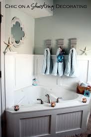 Coastal Bathroom Wall Decor by Chic On A Shoestring Decorating Beachy Bathroom Reveal