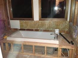 Tiling A Bathtub Deck by Help How To Build Continuous Tub Deck Shower Bench Ceramic