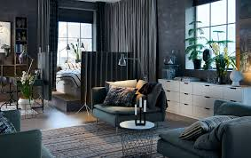 Dark Grey Open Plan Studio With A Bed In The Corner Surrounded By Room Dividers