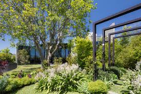 100 Garden Home Design A Concrete House With A Striking Form And Lush Wild Garden