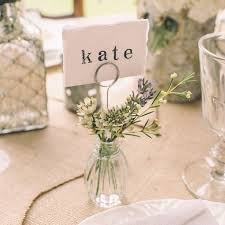 Doubling As Vases For White Carnations Simple Wedding Place Cards Are Tucked Into Clear Glass