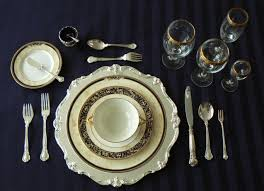 Formal Place Setting With Oyster Fork On The Right And Dessert Spoon Above