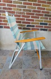 Vintage High Back Folding Lawn Chair From Telescope Folding Furniture,  Telaweave Vinyl Mesh Arm Chair, Striped Patio Chair Flash Fniture Kids White Resin Folding Chair With Vinyl How To Save Yourself Money Diy Patio Repair Aqua Lawn The Best Camping Chairs Travel Leisure Pair Of By Telescope Company Top 14 In 2019 Closeup Check Lavish Home Black Cushion Seat Foldable Set 2 7 Sturdy For Fat People Up To And Beyond 500 Pounds Reweb A 10 Easy Wooden Benches Family Hdyman Wrought Iron Ideas Outdoor Stackable