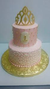 Pink White And Gold Birthday Decorations by Princess Tiara Two Tiered Cake Made With Buttercream Icing And