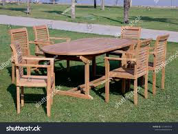 Garden Furniture Outdoor Teak Dining Table Stock Photo (Edit ... Cheap Teak Patio Chairs Sale Find Outdoor Fniture Set Fniture Tables On Ellis Ding Chair Stellar Couture Outdoor Shell Easy Shell Collection Fueradentro Amazoncom Amazonia Belfast Position Benefitusa Recling Folding Wood Set 1 Table 2 Chairs High Top Table And Round Buy Upland Arm In W White Cushions By Modway Petaling Jaya Selangor Malaysia Mallie And Wicker Basket Double Chaise Lounge With