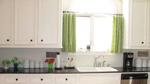 Creative Kitchen Window Ideas With Green Curtain Treatment Added White Cabinet Over Double Sink On Black Glass Countertop In Modern