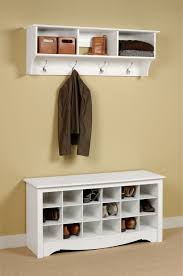 white stained wooden shoe cabinet organizer and hanging clothes as