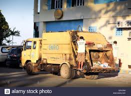 Garbage Truck Collecting Trash In Stock Photos & Garbage Truck ...
