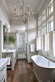 bright white gray wood master bathroom with a touch of