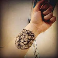 Leo Face Tattoo Design On Wrist Ideas For Guys