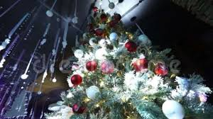 Christmas Tree With Ornaments Red Apples Hanging On The Dolly Of A Stock Video