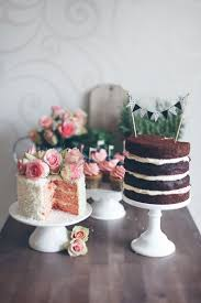 Naked Layer Cake With DIY Bunting Topper Coconut Topped Garden Roses Cupcakes Displayed On Different Tiered Stands For An Awesome Dessert