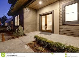 100 Contemporary House Siding New Construction Home With Low Slope Roof And Brown Stock
