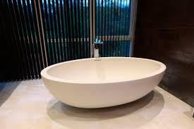 Kohler Freestanding Tub Faucet by Gorgeous White Oval Kohler Bathtubs With Tub Filler And Balck
