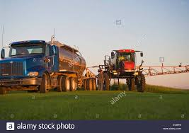 Tractor Filling Up Tanks From Fertilizer Truck Next To Crop Stock ... C Equipment Sales New And Used Ftilizer Spreaders Sprayers Trucks 2002 Terragator Spreader Floater Truck Chandler Ftlexw Lime Mount Truck Stock Image Image Of Summer Garden 2368747 Tenders Rayman Inc Bulk Wwarrenadamtruckscom Cps Real Estate Auction The Wendt Group Calibration Dry Applicators Uga Cooperative Applying Loral Products Leader Crop Nutrient