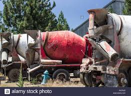 100 Salvage Trucks Row Of Abandoned Cement Mixer In Yard Stock Photo