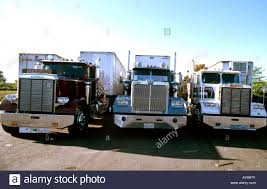 Trucks Lined Up At US Truck Stop In 1980s Stock Photo, Royalty ... Fileus Military Truck Offloadjpg Wikimedia Commons 1960s Volvo Trucks Us Army Truck Pictures Ustruck Stock Photo Cthroadrunner 3931006 Freightliner A Story Of Infinite Inspiration Lined Up At Us Stop In 1980s Royalty Smarttruck Topkit To Be Installed On All Xpress Trailers Gas Lpg Tanks Utility Kxta Pacos Nig Ltd Government Nuclear Transport Trucks Business Insider American Show Courses Nascar Tours Speedway 24 25 26 Bizarre Guntrucks Iraq Test Could Accelerate Autonomous Driving