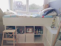 bed made out of 3 kallax closets and a billy closet from