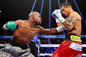 Floyd Mayweather Jr L Throws A Left To The Body Of Marcos