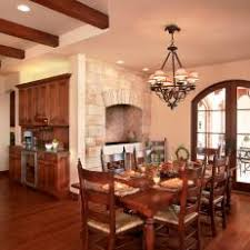 Open Traditional Dining Room With Wood Set Up Arched French Doors And Wrought Iron Chandelier