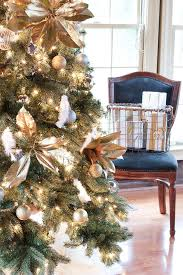 I Added Magnolia Branches From The Tree In Our Yard Which Spray Painted Gold Also Bought A Package Of Plain White Feathers At Craft Store And