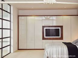 Television screen integrated into closet doors Integrated tv